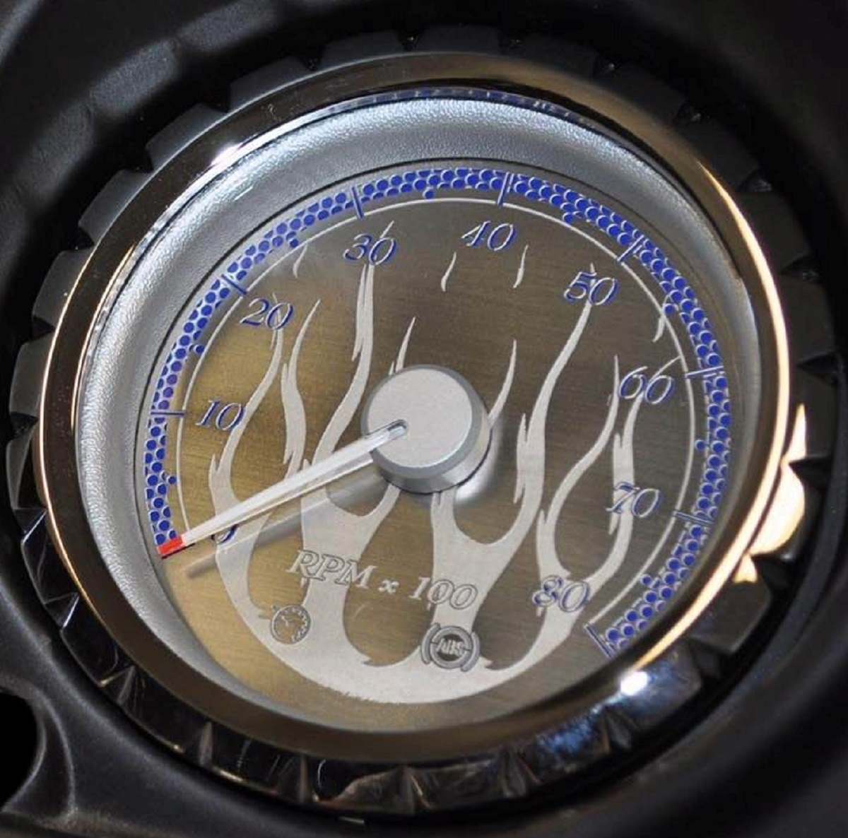 Stainless steel face: with flames, blue background, and billet bezels.